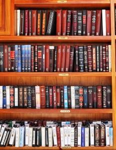 Hebrew books on wooden shelves.