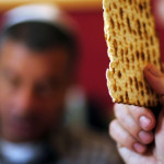 Holding a Piece of Matza