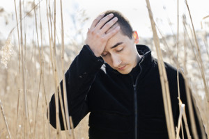 Depressed Man in Field