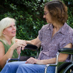 Caregiver With Wheelchair Confined Patient