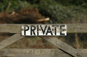 Private property warning sign on boundary gate