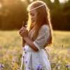 Little girl praying in field