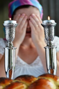 Woman Lighting Shabbat Candles