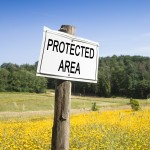 Protected area written on a field sign